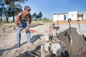 A project beneficiary who was helped to find work as a brickmaker.