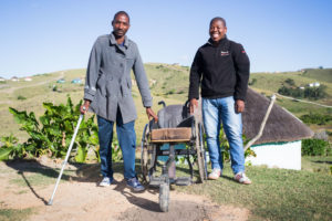 A community disability worker and client who learned to walk again after contracting TB spine.