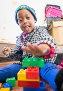 A child with developmental delay working on fine motor skills.
